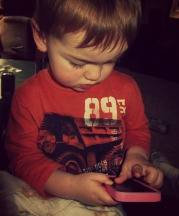 My two year old navigating the iPhone.