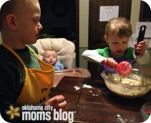 My two year old adding flour & mashing bananas at the same time.  She is either ambidextrous or doesn't like to share.