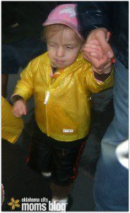 My daughter at age 3 running in the rain in the 2011 OKC kid's marathon.
