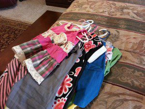 Buying clothes at consignment sales can ease the financial burden of buying clothes for the next season.