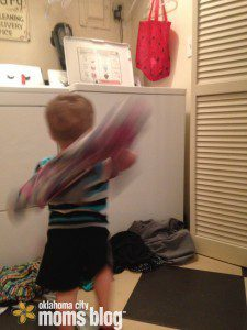 Helping mom by shooting laundry baskets.