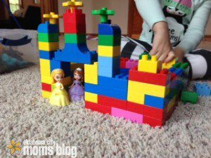 Two little princesses fit perfect in this rainbow colored castle.
