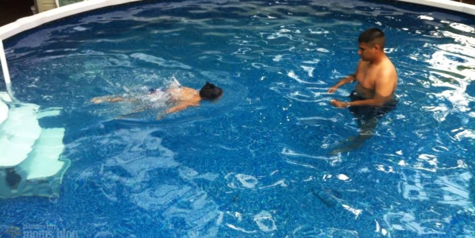 Your child will feel security swimming with you close by