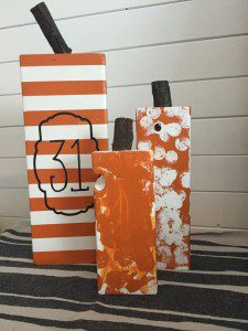 """A """"31"""" painted on the backside of the big pumpkin as an alternative Halloween decoration."""