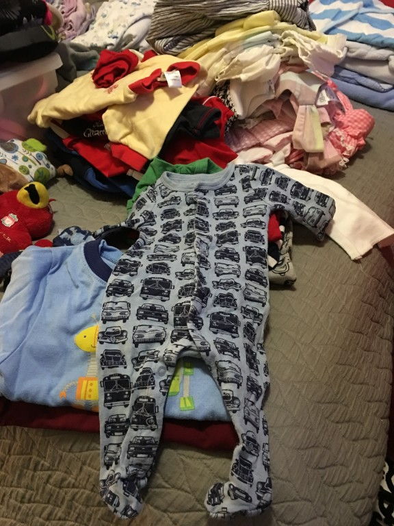 Big brother's hand-me-down clothes are good enough for the new baby!
