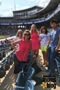 At a baseball game with students: Sarah from Norway, Hannah from Sweden, Valeria from Switzerland and Daichi from Japan