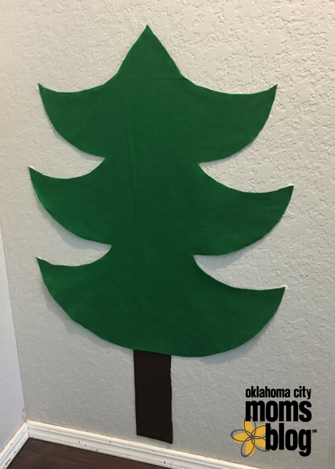 Attach the tree & stump to the wall using command strips.