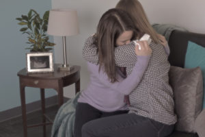 Friend comforting mother who miscarried.
