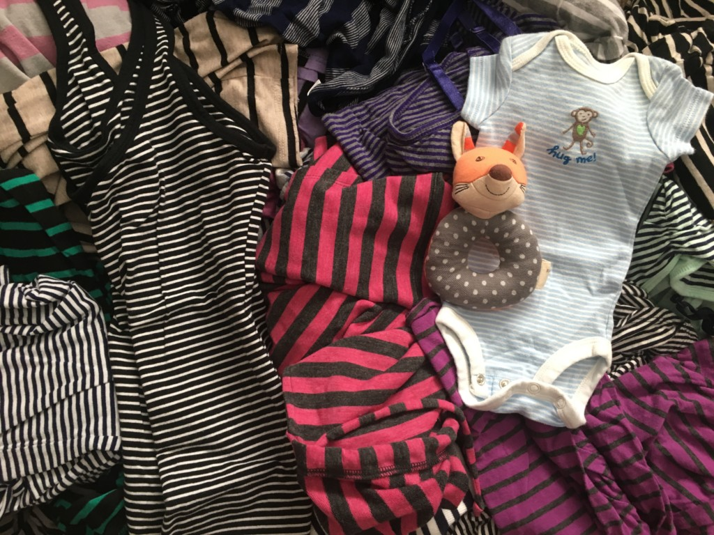 Pile of stripped maternity wear.