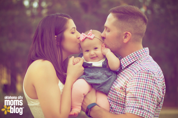 two people kissing baby