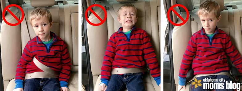 Child riding in a seatbelt incorrectly.