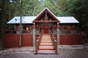 The secluded cabin is surrounding by hardwoods & pines