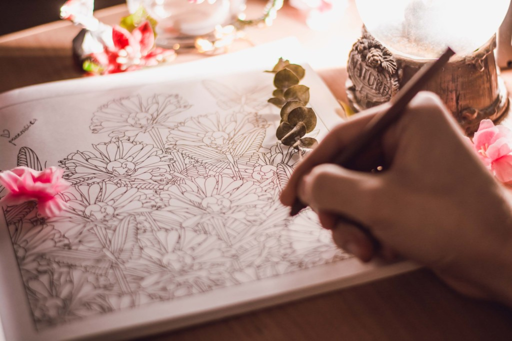 adult coloring in a book